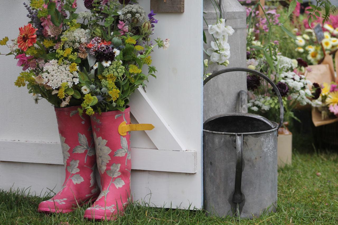 In The Garden Fresh Flowers Garden Garden Patch Grass Pink Tin Can Tin Watering Can Vintage Watering Can Watering Can Wellington Boots