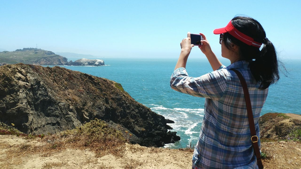 Capturing California's summer on the coast. Camera - Photographic Equipment One Person Real People Outdoors Beach California Coast Photographer Woman Taking Picture Tourist Traveling EyeEm Travel Photography California Summer Enjoy The New Normal Ocean By The Sea Memories