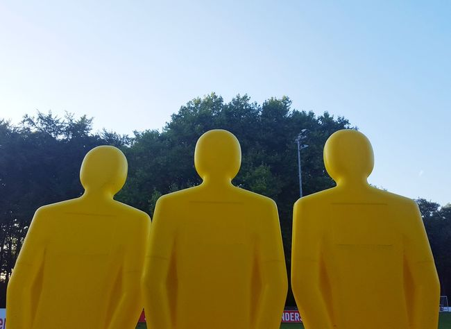 Statue Low Angle View In A Row Yellow Majestic Respect Strangers Fear Figure Dummy Blank Hollow Fake Confrontation Face-Off Clear Sky Total Strangers Unreal Pseudo Barrier Blockade