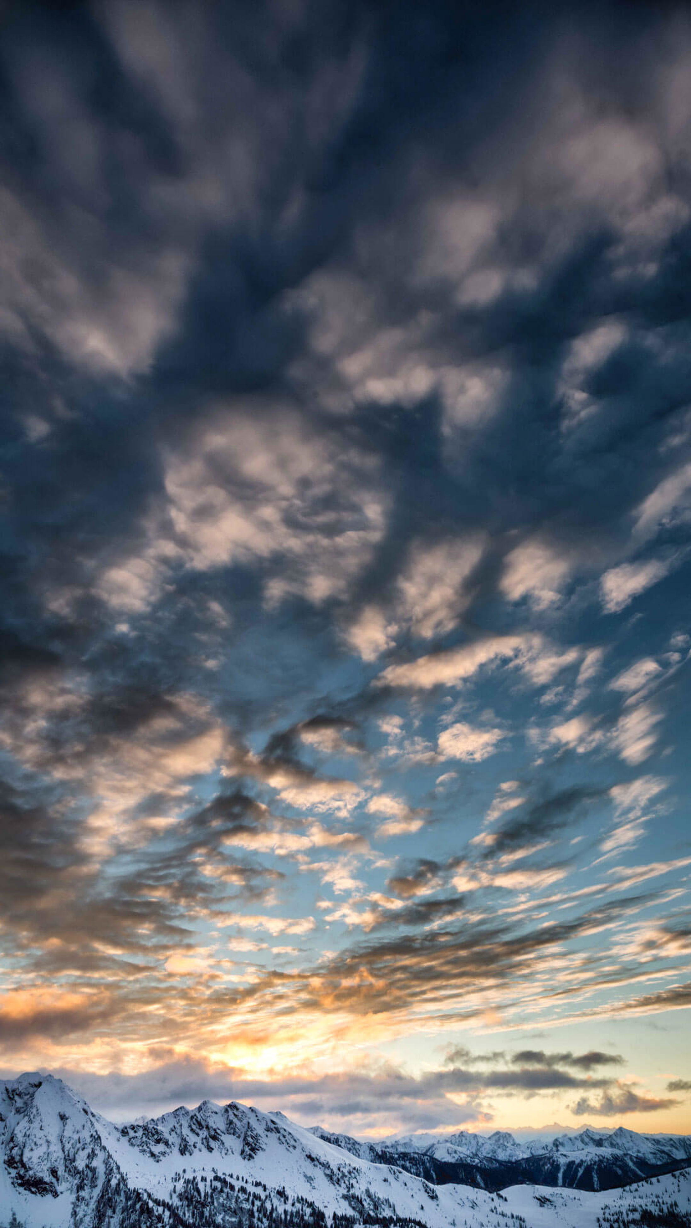 cloud - sky, dramatic sky, landscape, sunset, scenics, nature, beauty in nature, cloudscape, awe, no people, mountain, storm cloud, outdoors, sky, extreme weather, day