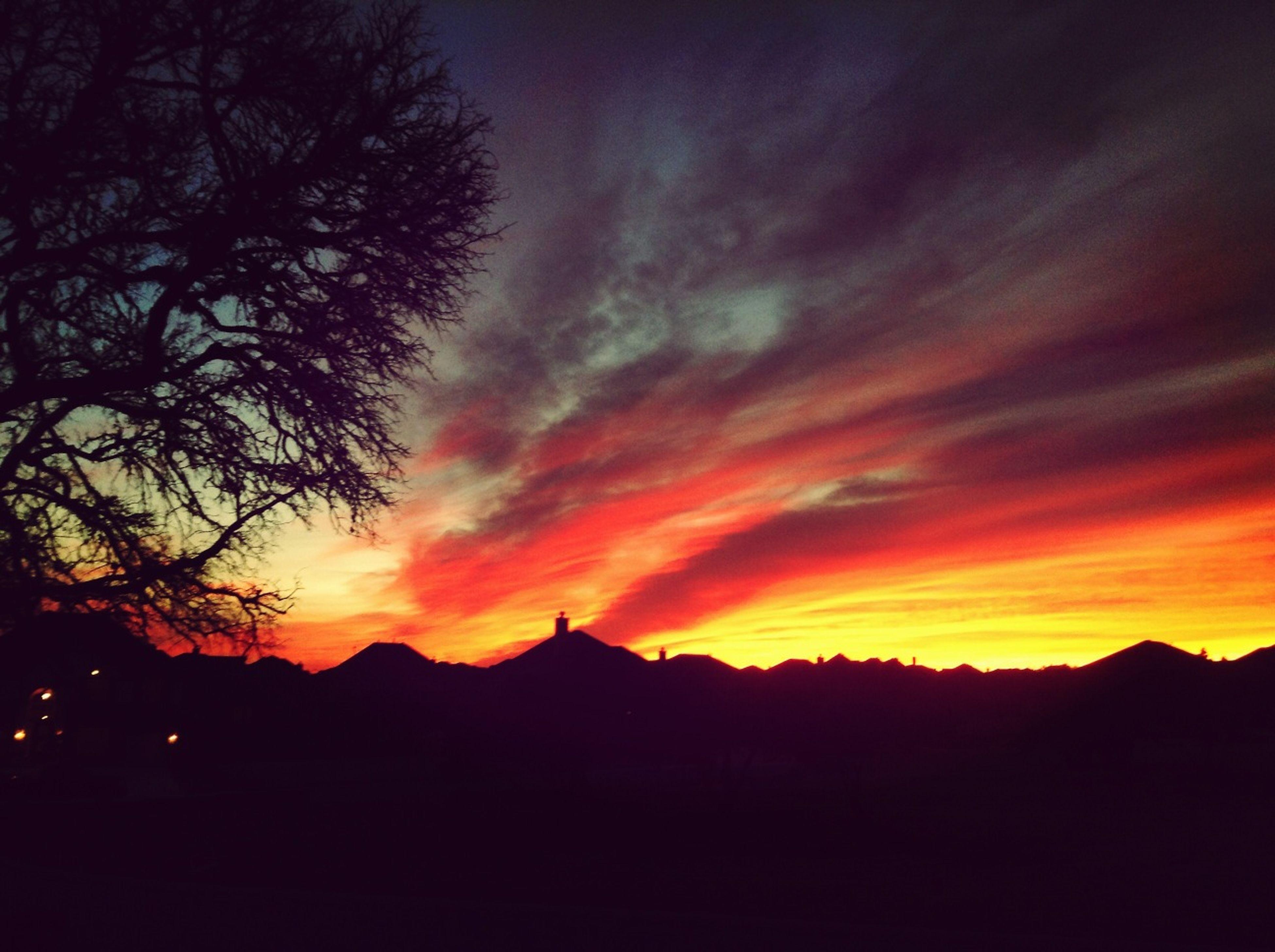 sunset, silhouette, scenics, tranquil scene, beauty in nature, tranquility, sky, orange color, tree, nature, idyllic, dramatic sky, landscape, mountain, cloud - sky, majestic, dark, cloud, dusk, moody sky
