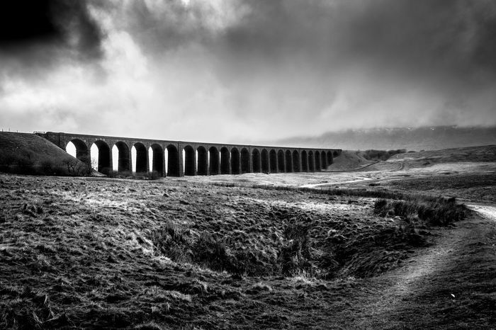 Final edit for today, hopefully more coming tomorrow Arch Arch Bridge Atmospheric Mood Black & White Blackandwhite Photography Bridge Bridge - Man Made Structure Connection Dirt Road Landscape Landscape_Collection Landscape_photography Leading Moody Sky Nikon D3300 No People Outdoors Power In Nature Ribbleheadviaduct The Way Forward Tranquil Scene Yorkshire EyeEm Best Shots
