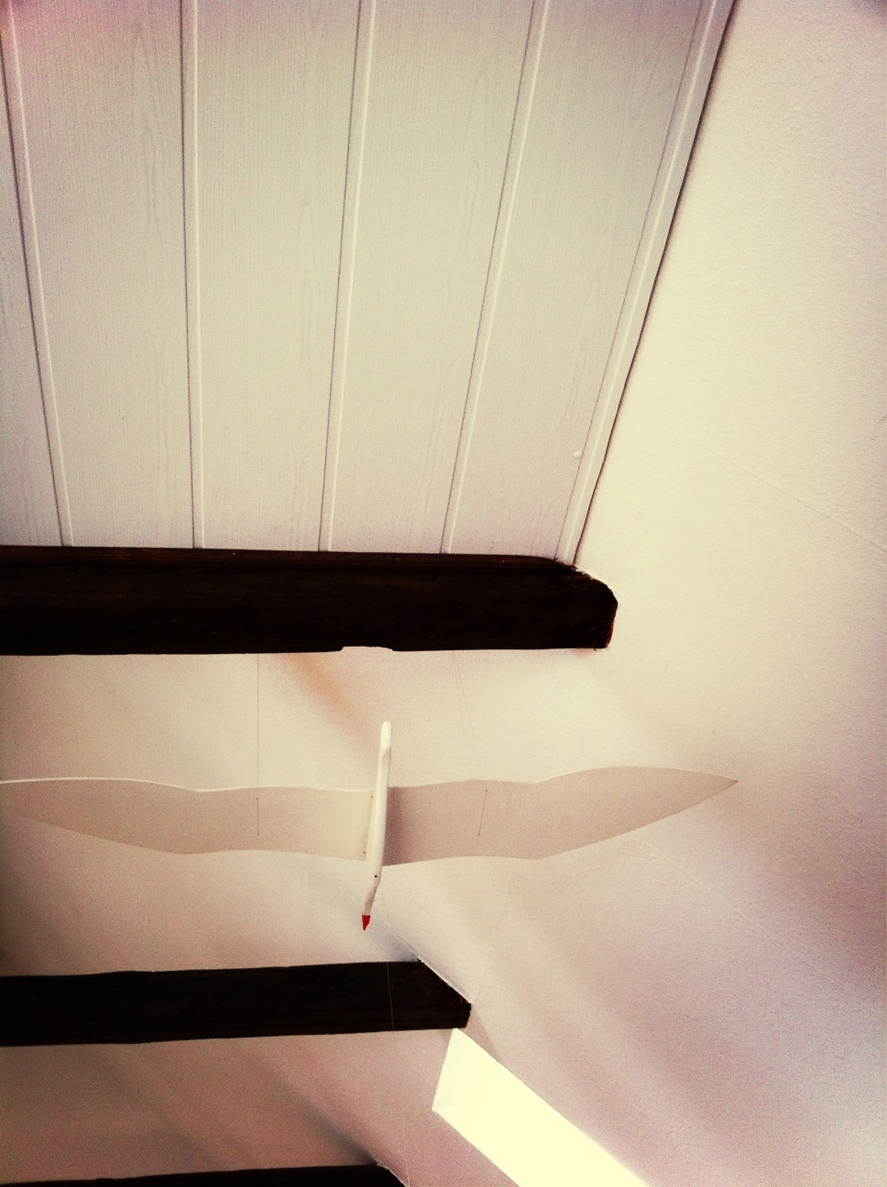 indoors, pattern, shadow, wall - building feature, part of, high angle view, close-up, no people, design, sunlight, built structure, single object, absence, cropped, home interior, architecture, wall, steps, still life, white color