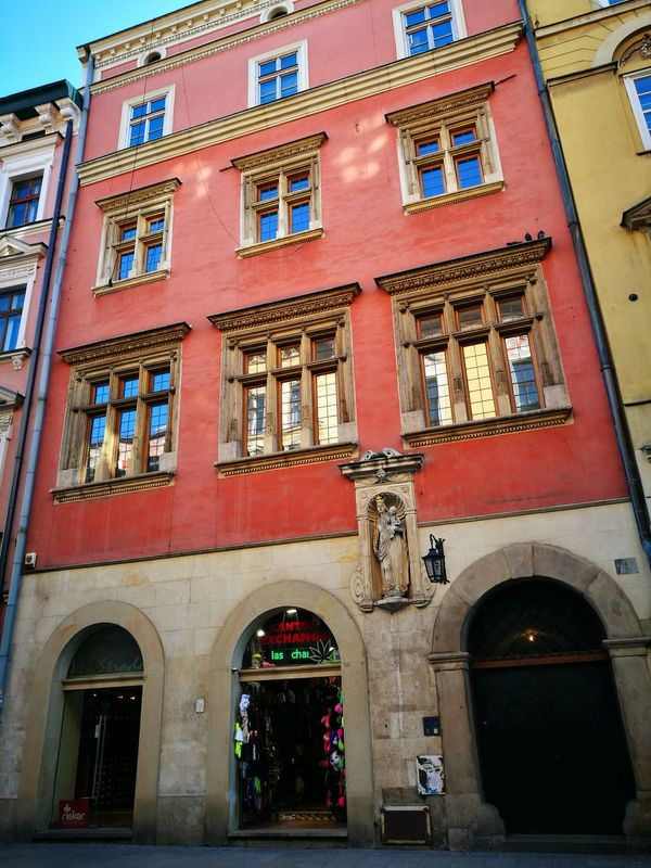 Architecture Red Building Exterior City Travel Destinations Built Structure History Outdoors Façade Business Finance And Industry Day No People Clock Contrast Color Building Architecture_collection Building Colour Color Kraków, Poland Streetview Krakow Streetview Architecture Cityscape Travel