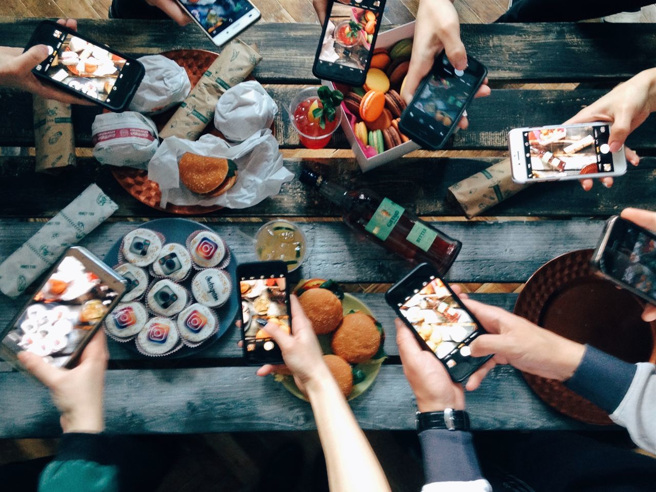 People using mobile devices Human Hand Real People Food And Drink High Angle View Food Human Body Part Table People Using Laptop Mobile Phone Technology Using Phone Using My Mobile Bloger Burgers Food And Drink
