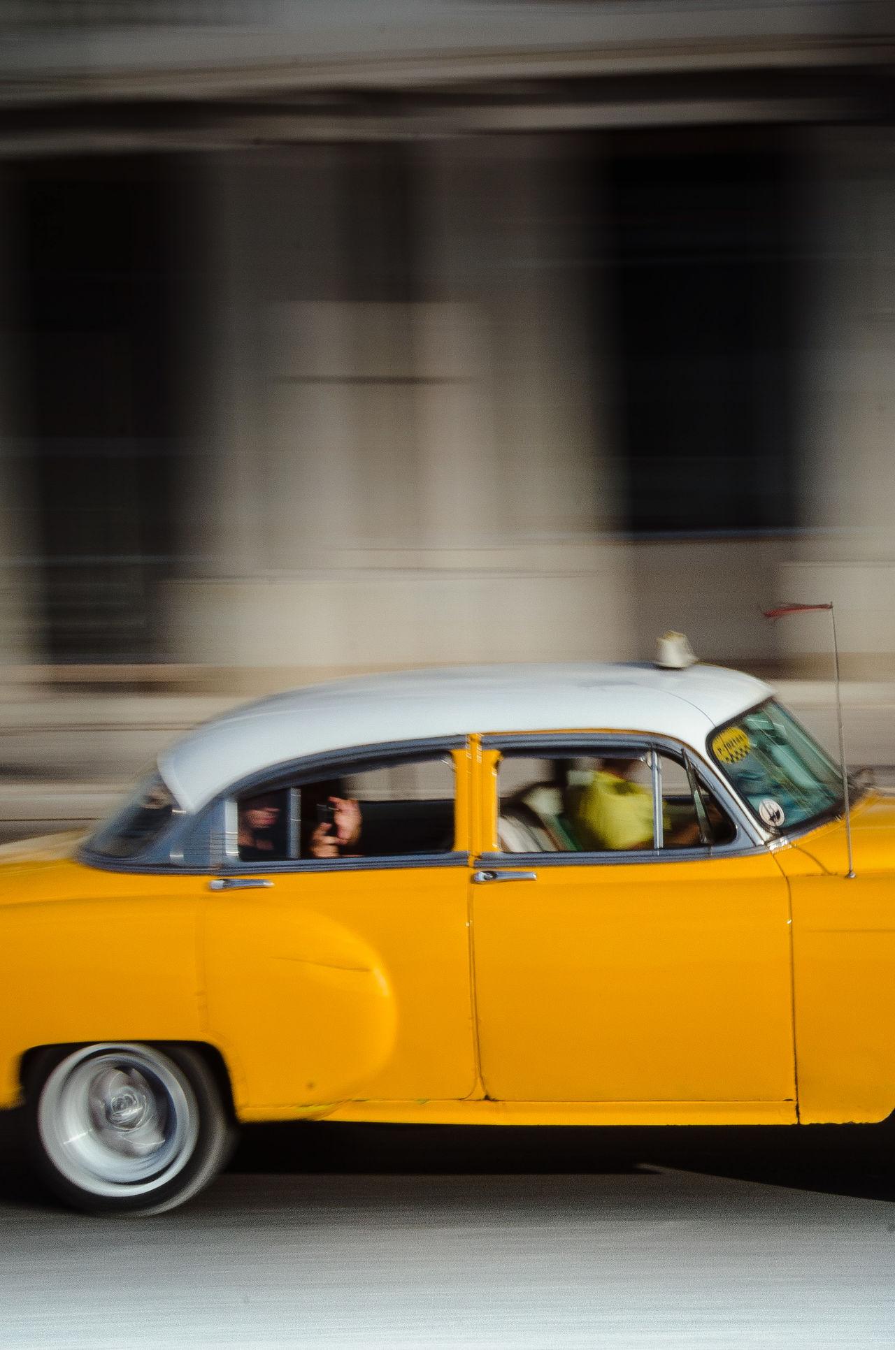 Taxi yellow taxi car yellow Transportation mode of transport outdoors City people day one person streetphotography EyeEm street photography EyeEm Best Shots cuba havana street Cuba havana Malecon