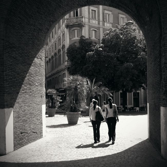Arch Architecture Building Building Exterior Built Structure City City Life Culture Day Historic History Incidental People Italy Light And Shadow Narrow Outdoors Real People Rome Shadows Street Tree Via Veneto Walking Women Young Adult
