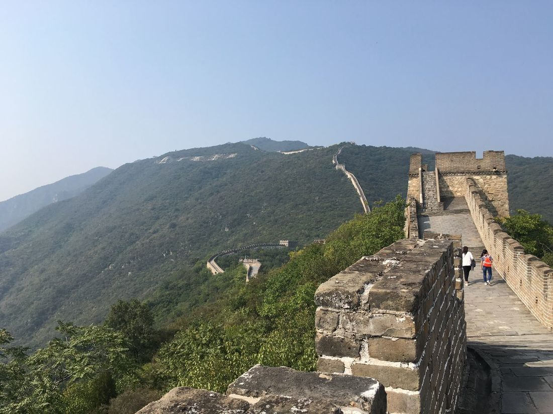 Ancient Architecture Built Structure Clear Sky Culture Famous Place Footpath Fortified Wall Great Wall Of China Great Wall Of China History Incidental People International Landmark Mountain Stone Material Stone Wall Surrounding Wall The Past Tourism Tourist Tranquil Scene Tranquility Travel Travel Destinations Vacations