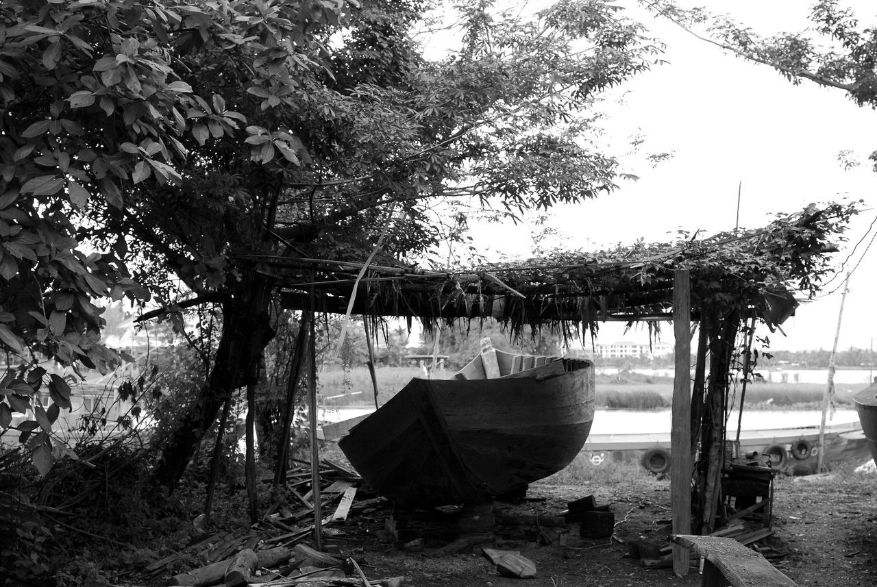 Boat building in Hoi An, Vietnam Black And White Black And White Photography Boat Boat Building Craft Day Growth Hoi An Hoi An, Vietnam Laundry Nature No People Outdoor Play Equipment Outdoors Sky Summer Sunshade Tranquil Scene Tranquility Tree Tree Trunk Vacations