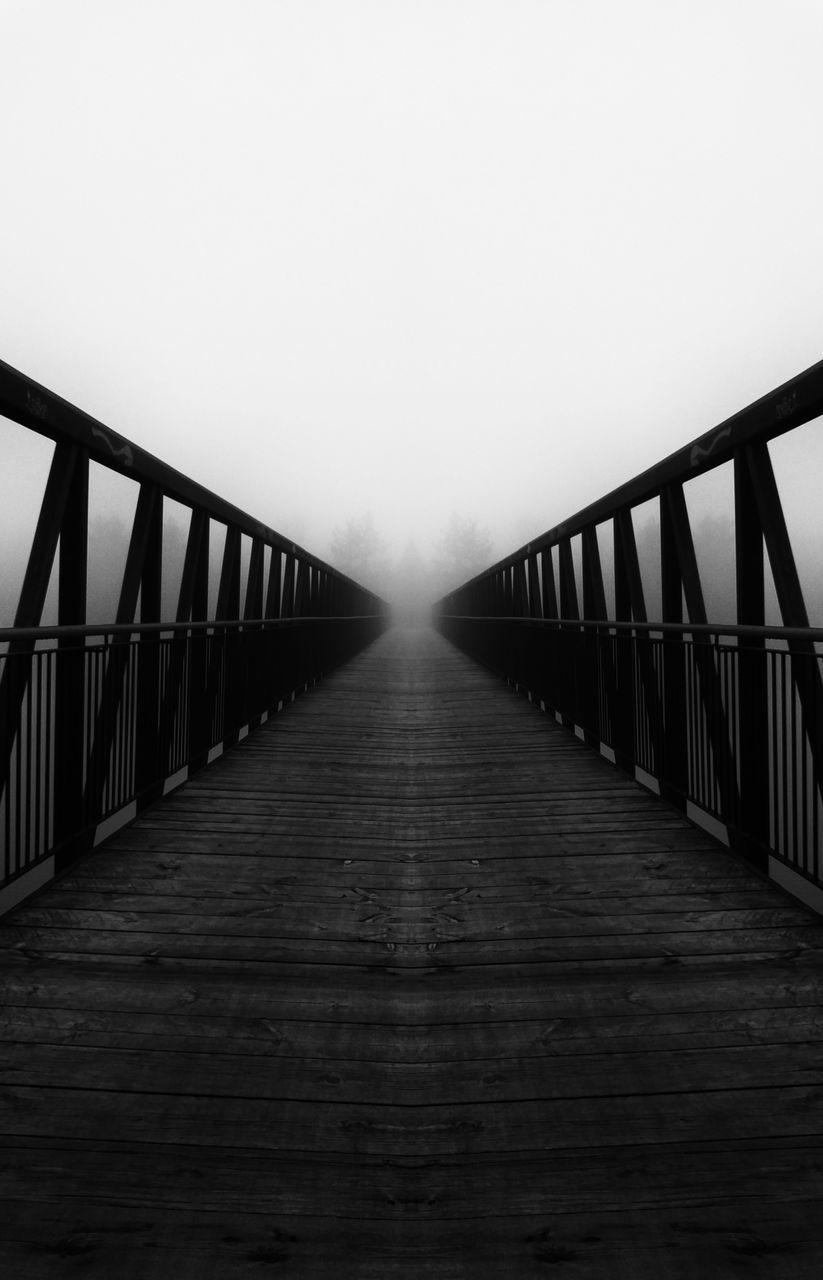 railing, the way forward, bridge - man made structure, fog, copy space, weather, outdoors, connection, built structure, no people, nature, day, footbridge, architecture, sky, water