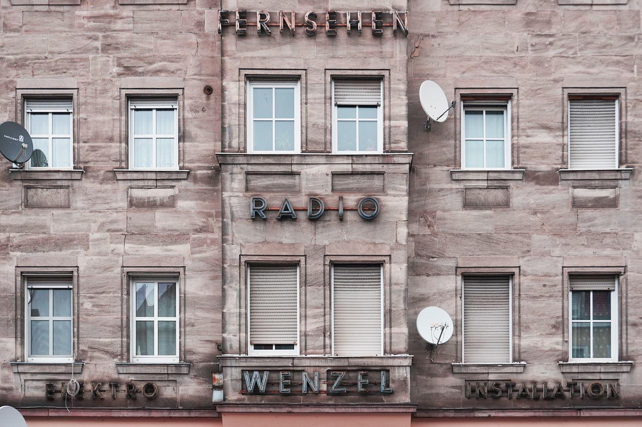 Architecture Building Exterior Built Structure Façade Lettering Signage Window