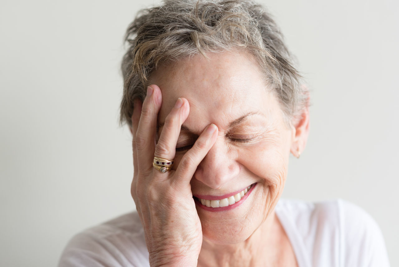 Laughing older woman Adult Adults Only Beautiful People Beautiful Woman Beauty Cheerful Close-up Front View Happiness Headshot Human Body Part Human Hand Indoors  Mature Adult One Person One Senior Woman Only One Woman Only Only Women Portrait Real People Retirement Senior Adult Senior Women Smiling Women