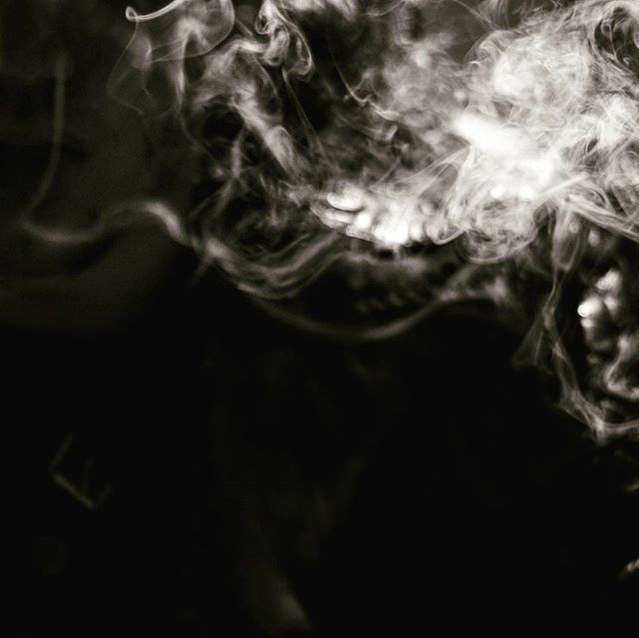 smoke - physical structure, close-up, motion, no people, black background, indoors, day