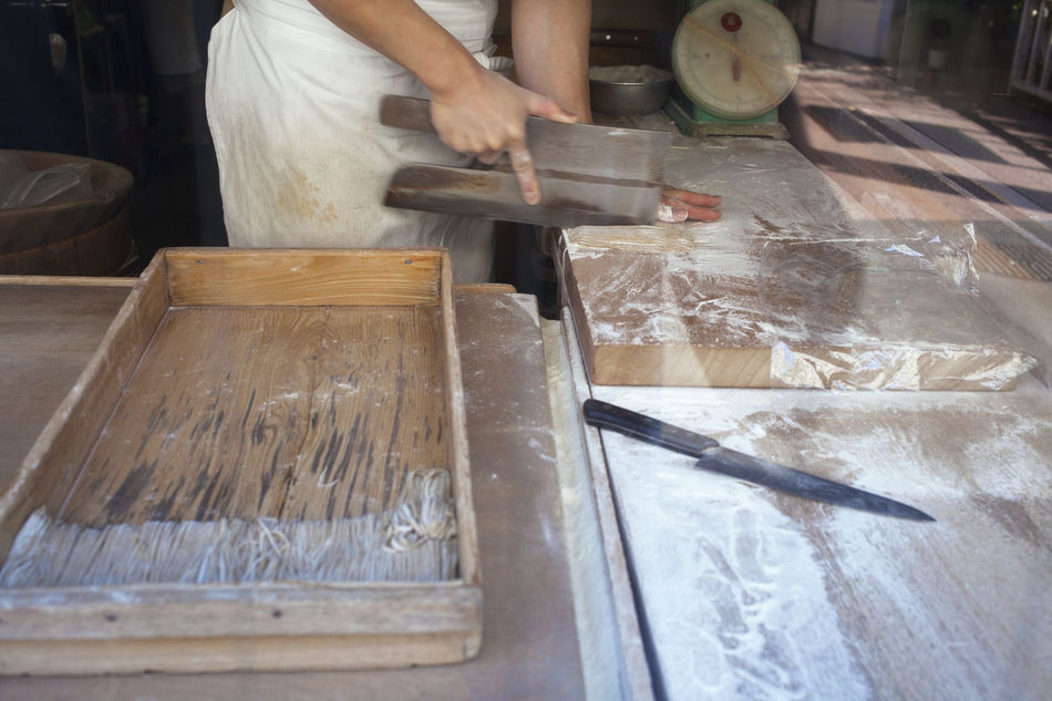 From cutting board to plate. Fresh soba in Japan. Craft Craftsmanship  Cutting Cutting Board Handmade Human Hand Indoors  Japanese Food Japanese Style Japanese Traditions Occupation One Person People Preparation  Preparing Food Real People Soba Noodles Table
