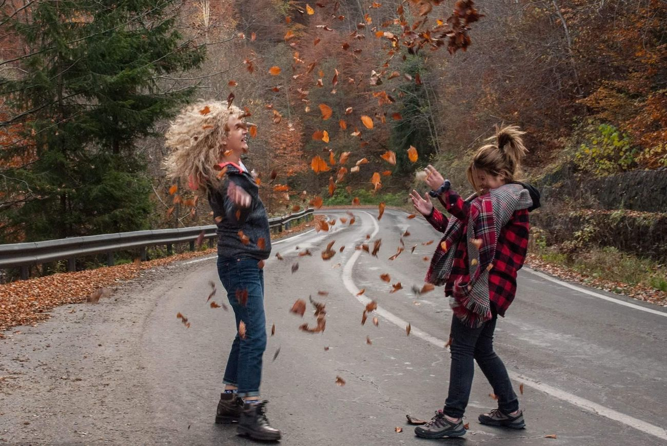 Enjoy The New Normal Autumn Two People Tree Friendship Leafes Fun Outdoors Streetphotography Autumn Colors Playing Nature Naturelovers Happiness Childhood Forest Togetherness Vacations Relaxing Taking Photos Bonding Smile Hello World Transfagarasan leaves fight! 🤗😍🌞🍁🍂🍃🍁🌲🍂
