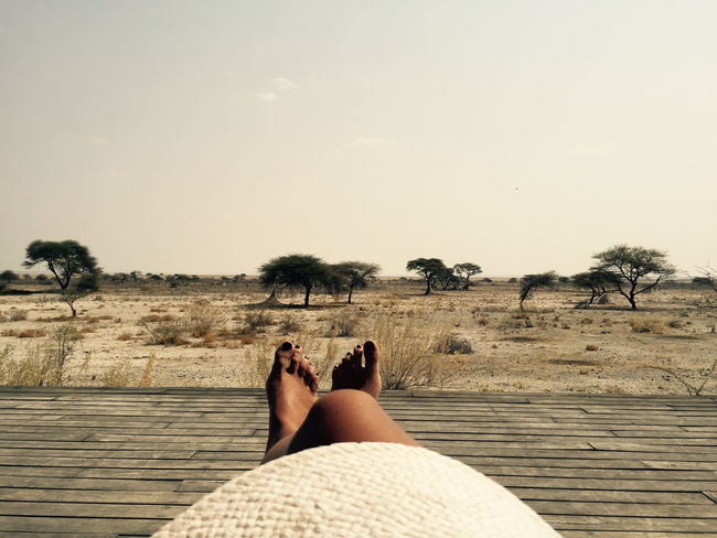 Barefoot Desert Desert Beauty Etosha National Park Human Foot Leisure Activity Lifestyles Low Section Namibia One Man Only One Person Outdoors Person Personal Perspective Relaxation Safari Sand Savannah Summer Sunbathing Tan Vacations