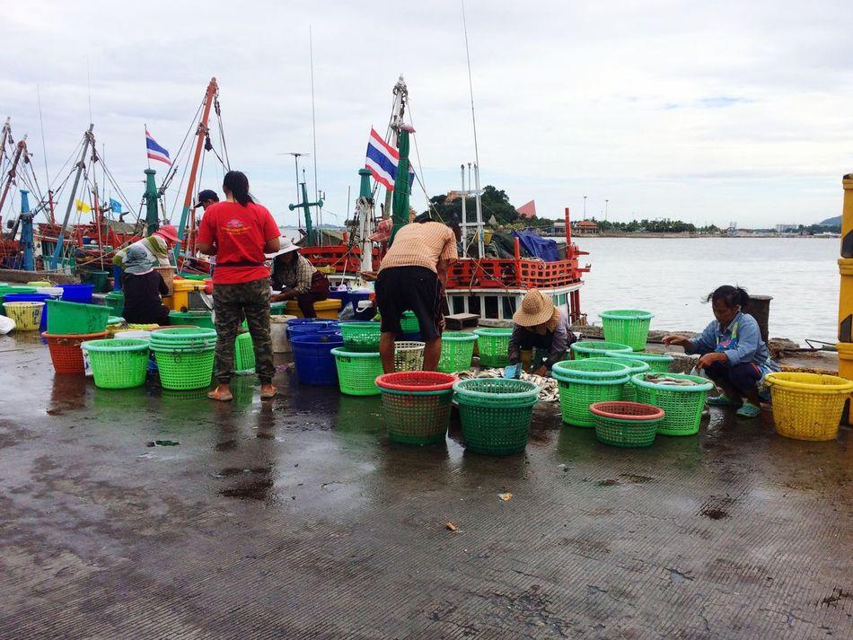 Port Jetty, Pier Fisherman Working People Portrait port of ferry at Si Racha, Chonburi, Thailand.