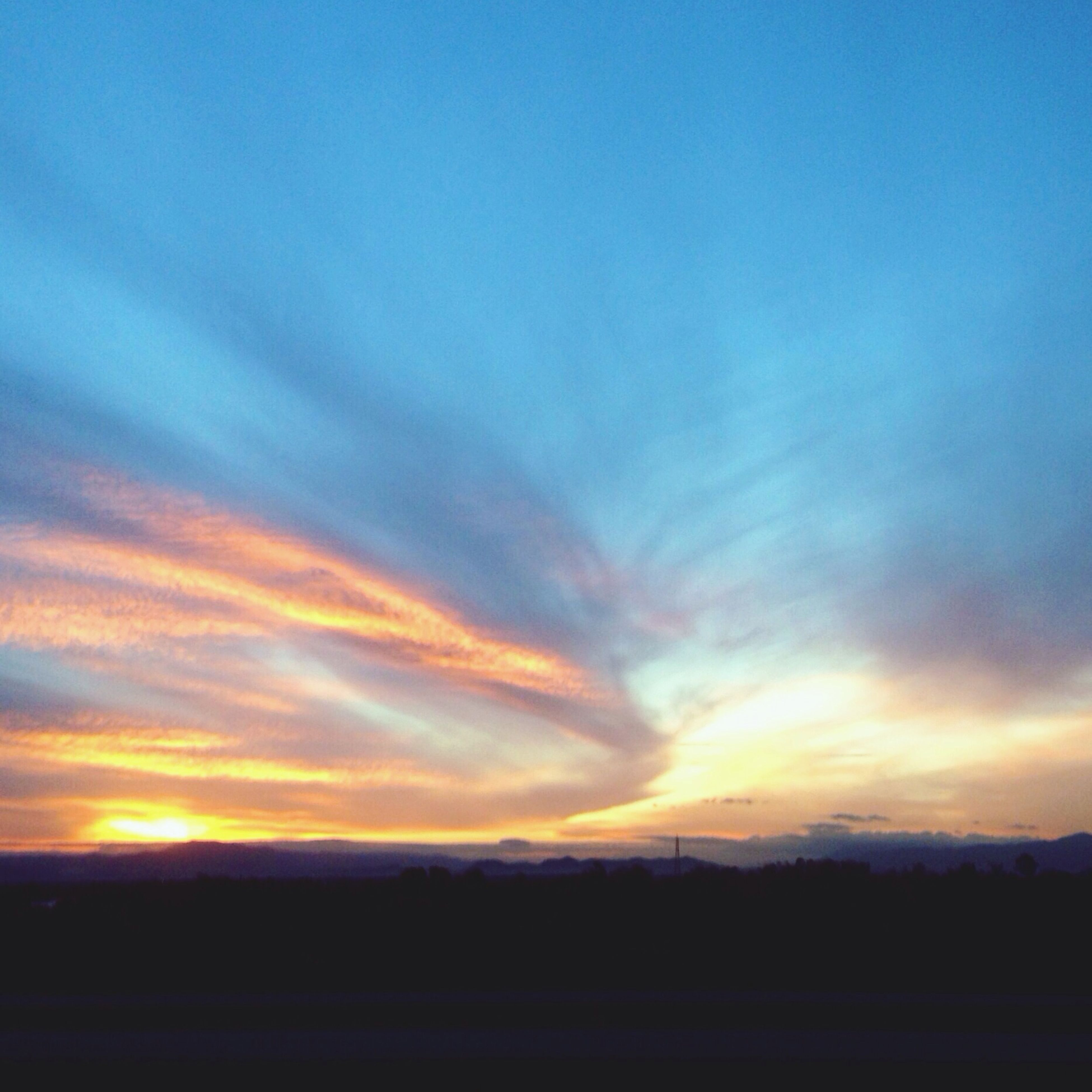 sunset, scenics, silhouette, tranquil scene, tranquility, sky, beauty in nature, orange color, landscape, nature, idyllic, cloud - sky, blue, cloud, copy space, dramatic sky, dusk, outdoors, field, no people