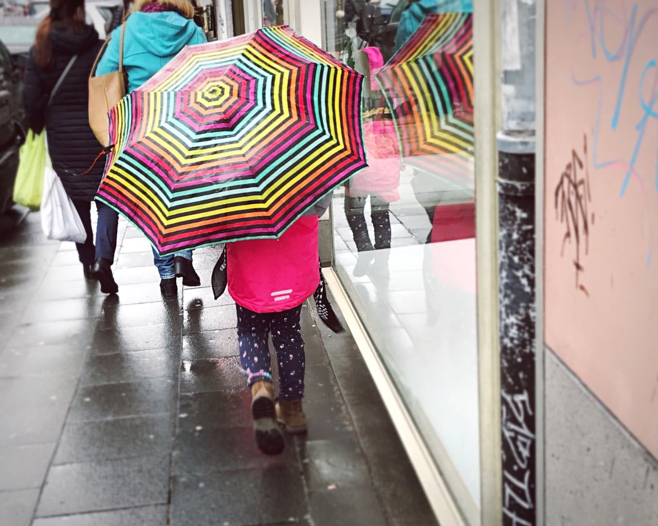 Happy in the Rain Rainy Days Low Section Multi Colored Consumerism People Outdoors Kids Streetphotography Street Fashion Urban Lifestyle City Life EyeEm Gallery Colors Reflection Window Reflections Millennial Pink