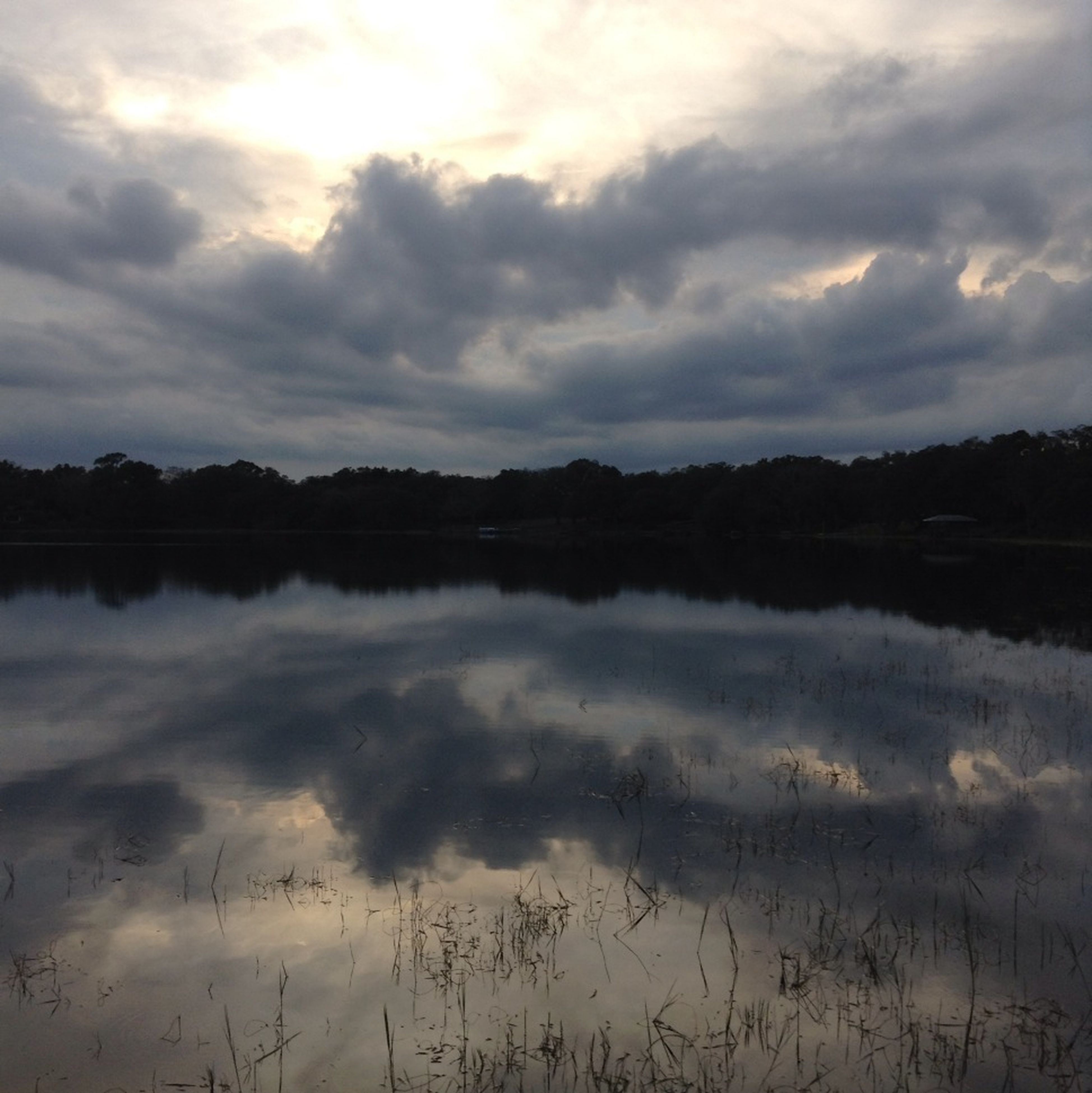 sky, reflection, water, tranquil scene, cloud - sky, lake, tranquility, scenics, beauty in nature, cloudy, nature, cloud, tree, idyllic, weather, sunset, standing water, non-urban scene, outdoors, calm
