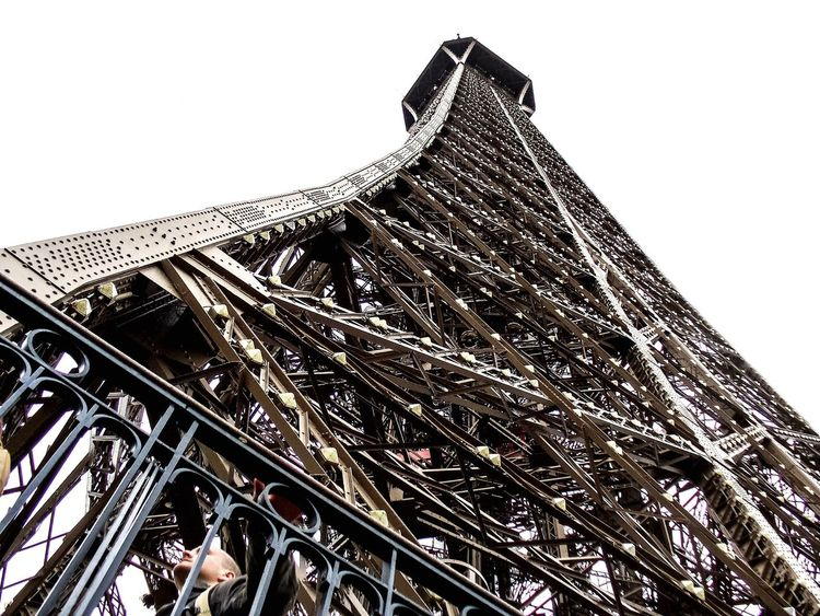 Low Angle View Architecture Built Structure Building Exterior City Clear Sky Sky Tower No People Outdoors Day Eiffel Tower Paris Paris, France  Metal Metal Art Tallest Building Tallest Structure  Tall Structure Looking Up Landmark World Wonder Iconic Landmark Tower France