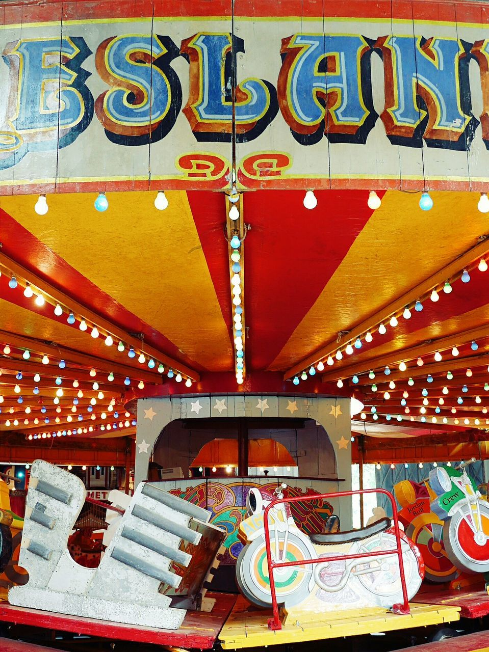 amusement park, multi colored, arts culture and entertainment, illuminated, no people, carousel, amusement park ride, outdoors, day