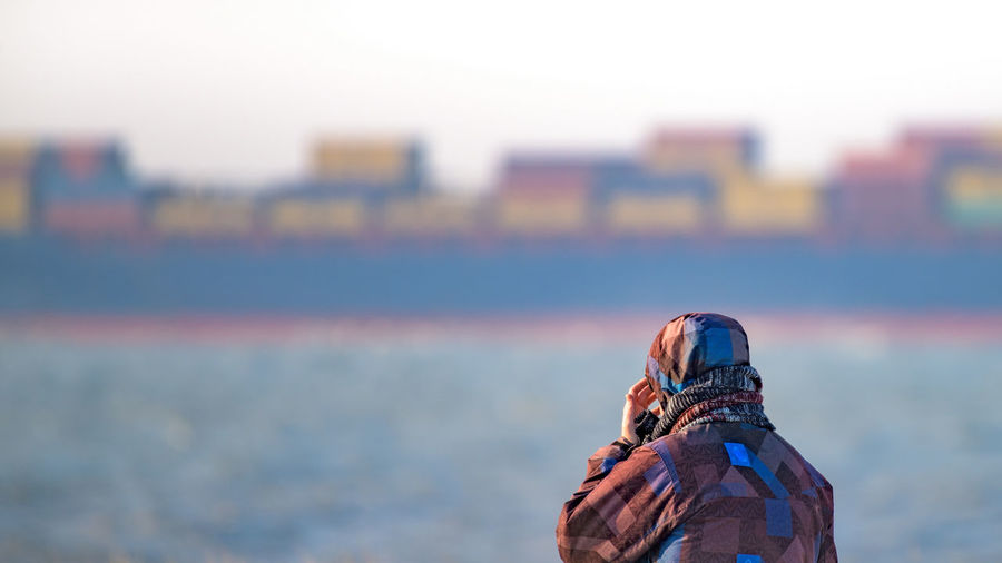 """Container shipping (Nikon D810 200-500mm f/5.6 ƒ/5.6 500mm 1/400"""" iso 100) 16x9 Blocks Breskens Container Container Ship Copy Space Focus On Foreground Landscape Multi Colored Netherlands Outdoors Person Selective Focus Ship Squares Trade Transportation View Www.benjaminvanderspek.com Zeeland  Up Close Street Photography"""