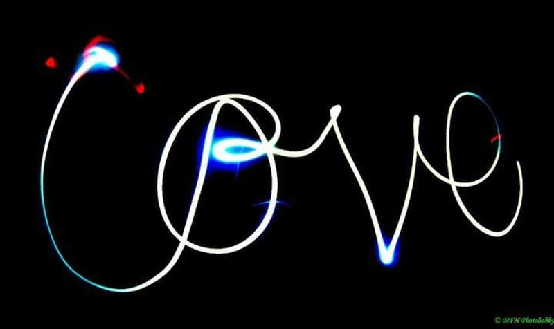 Illuminated Neon Night Communication Multi Colored Dark Western Script Glowing Lighting Equipment Neon Light Studio Shot Blue Colorful Black Background Outdoors Creativity Light Painting Lit Green Color Vibrant Color Art Is Everywhere