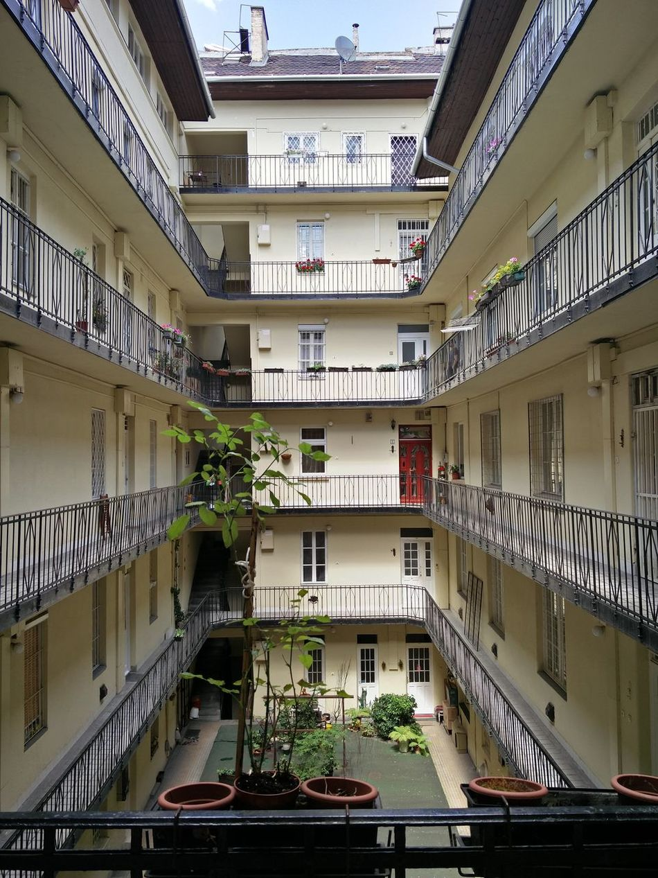 Built Structure Architecture Business Finance And Industry City No People Space Air Conditioner Day City Living Living Conditions Dense Living Budapest Hungary Yellow