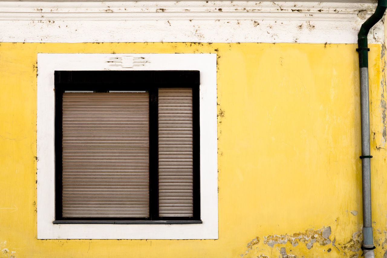 Closed Window Of Yellow House