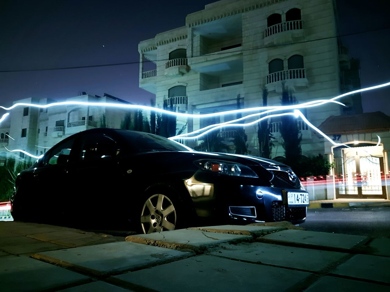 car, night, transportation, land vehicle, illuminated, mode of transport, building exterior, built structure, architecture, outdoors, city, road, no people, sky