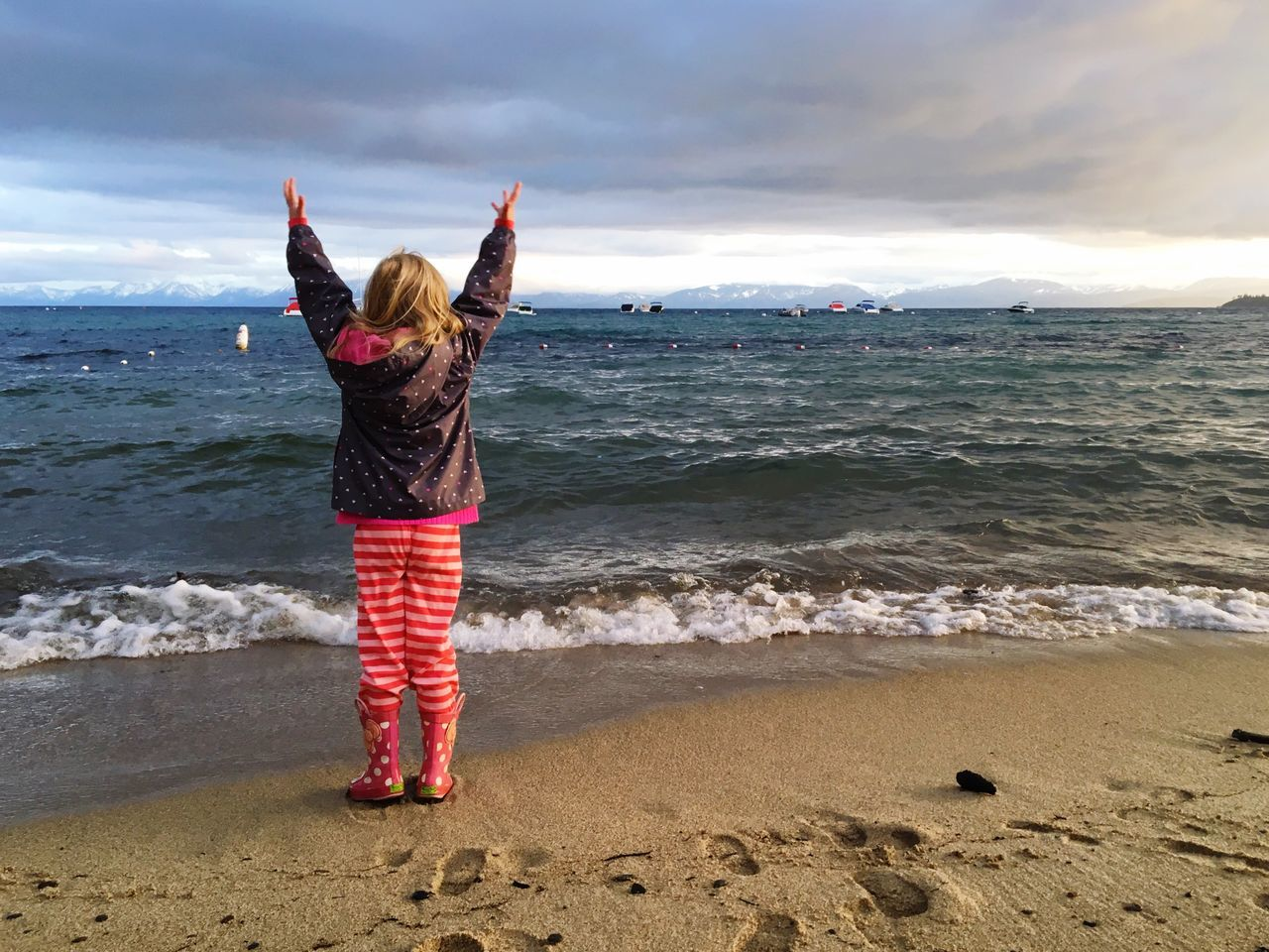 Lake Tahoe Lake Lakeside Girl Child Orchestrating Arms Up Beach Storm Clouds Childhood Feel The Journey Girl Power Original Experiences The Magic Mission