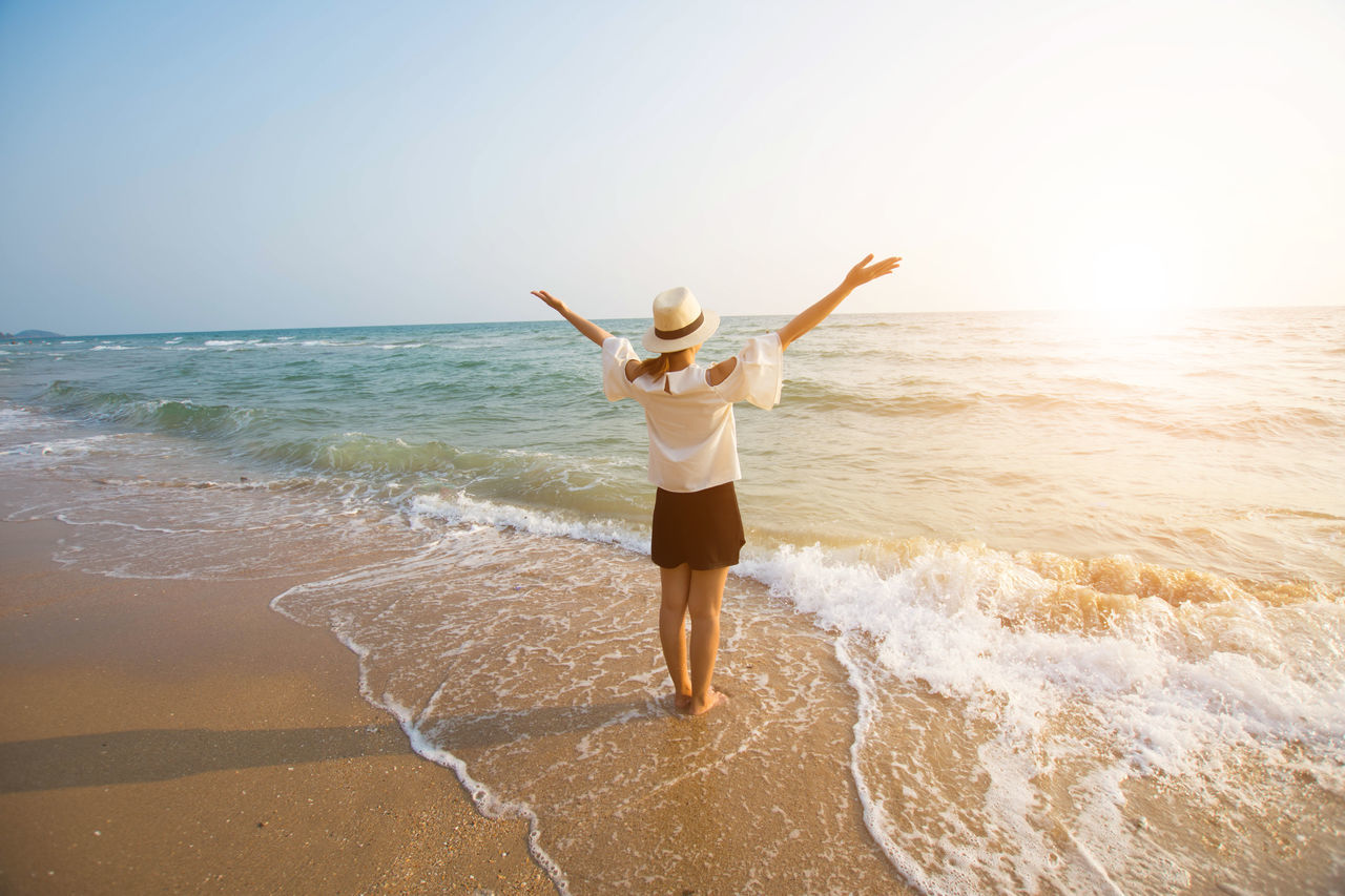 Beach Beach Holiday Carefree Cheerful Enjoyment Excitement Freedom Front View Fun Healthy Lifestyle Leisure Activity One Person One Woman Only Only Women Outdoors People Sand Sea Smiling Standing Surf Travel Vacations Vitality Women