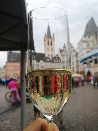 Drink Drinking Glass Architecture Close-up Outdoors Human Body Part Built Structure Building Exterior Day People Human Hand City One Person Real People Adult Cityscape Trier, Germany's Oldest City Trier City Sektglas View Happy Hours Mix Yourself A Good Time Your Ticket To Europe