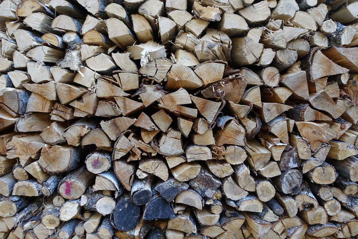 Norwegian wood Full Frame Timber Shapes Stack Woodpile Pattern Ready For Winter
