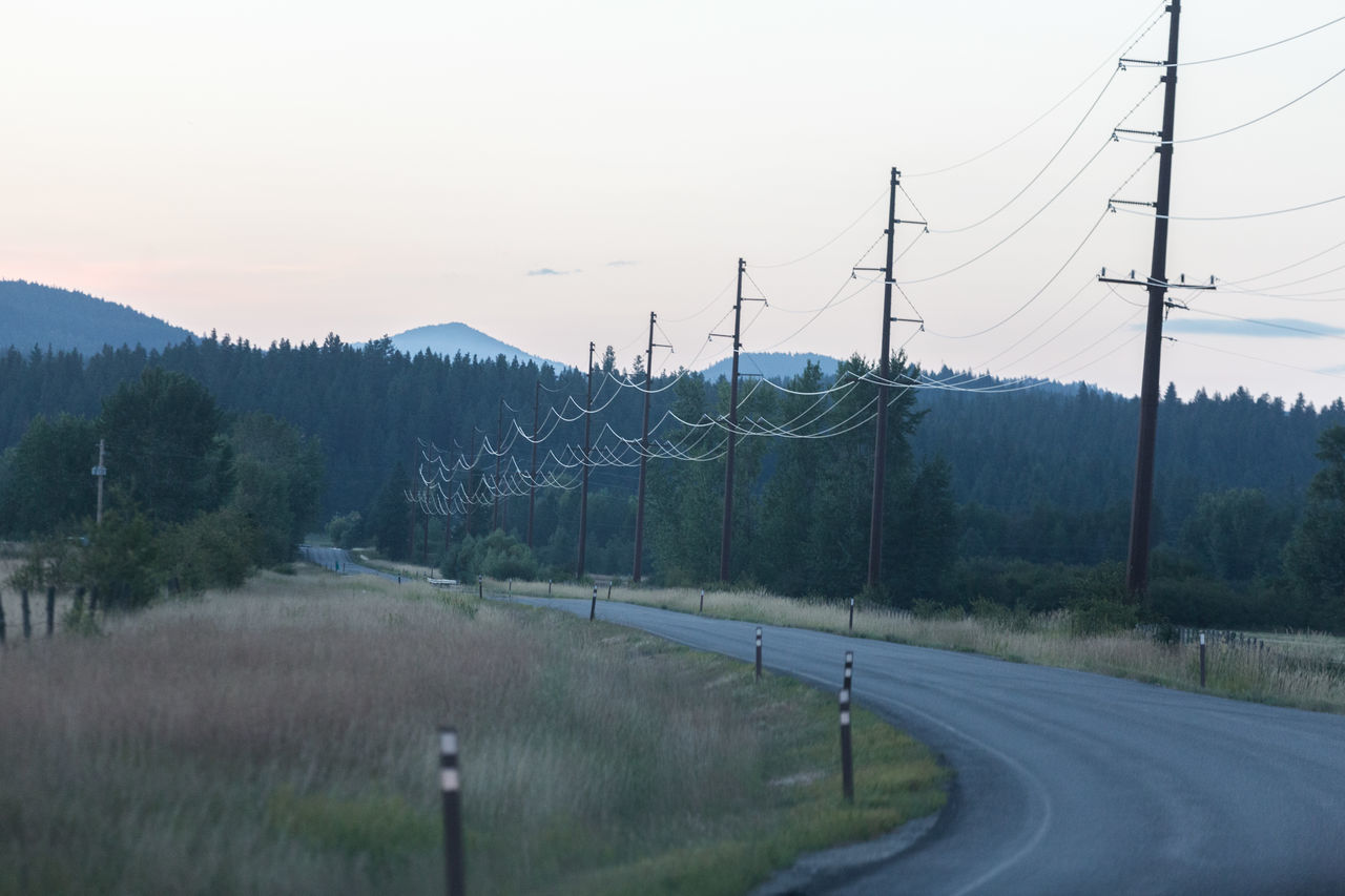Power lines on backroads in British Columbia, Canada. Backroads British Columbia Connectivity Phone Lines Power Lines Road To Nowhere Technology Technology Addiction