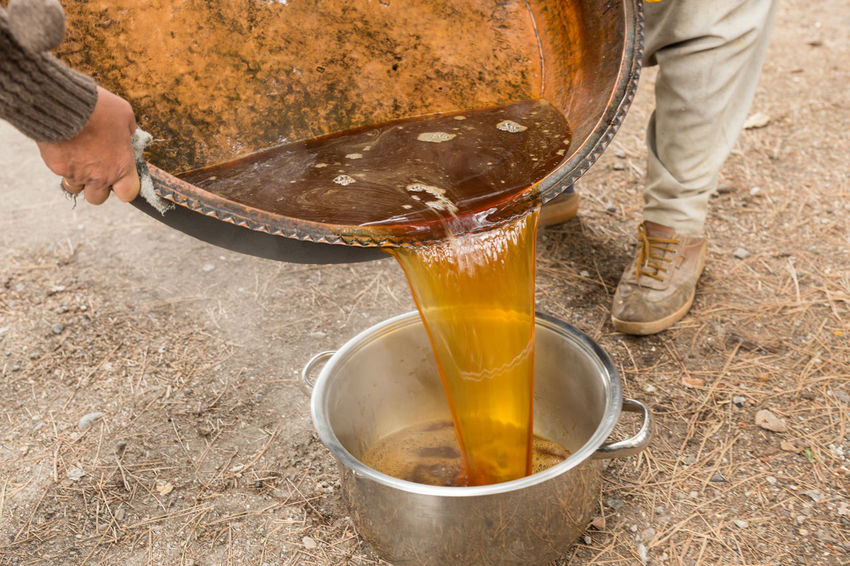 preparation of Turkish pekmez (a form of molasses) Food Foot Hand Kazan Liquid Molasses Outdoors Pans Pekmez Pekmez Yapimi Pots Pouring Preparation  Turkey