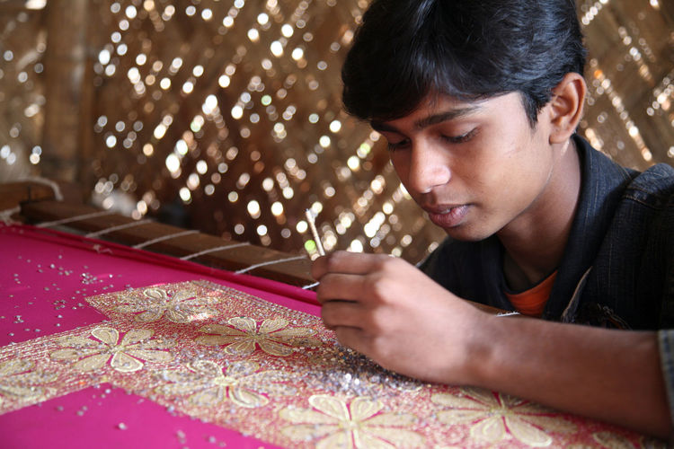 Child workers working on the decoration of textiles in Kumrokhali, India on Jan 16, 2009. Child Childhood Children Employment India Job Kid Kumrokhali Laborer Person Poor  Poverty Teenager Textile Underpaid West Bengal Worker