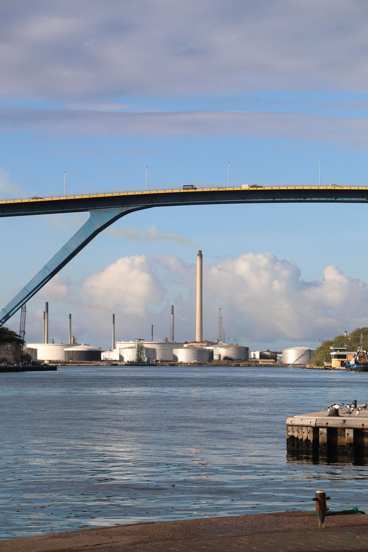 Architecture Bridge - Man Made Structure Built Structure City Cloud - Sky Connection Day No People Outdoors Refinery Sky Water Waterfront