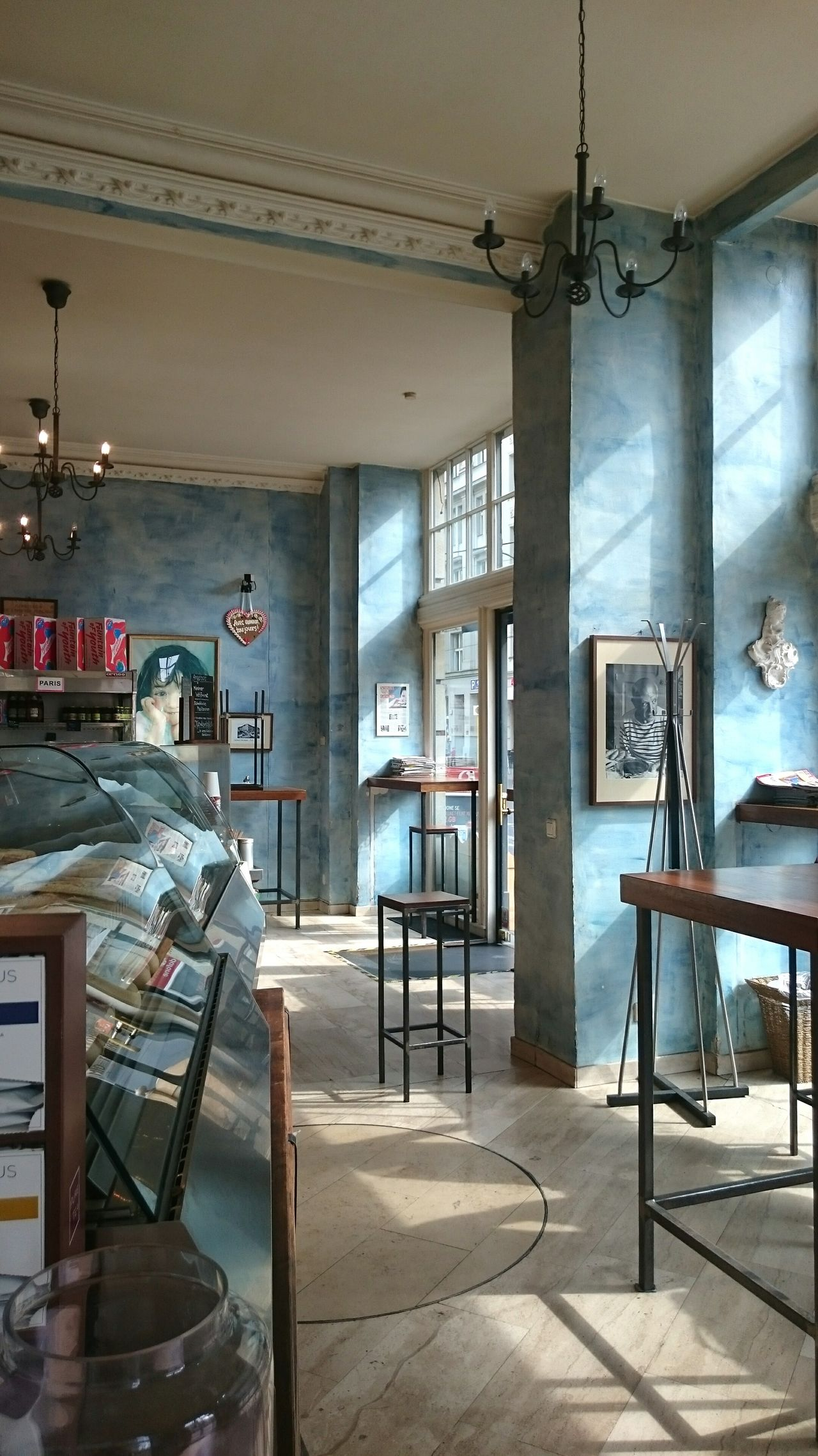 Cafe In Berlin French Style Cafe Interior Photography The Cage On The Corner Markanns Berlin Mitte Blue Wall Sun Through The Window