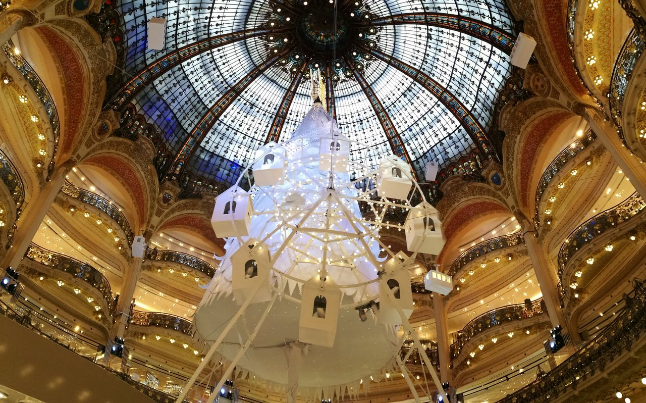 low angle view, ceiling, architecture, indoors, dome, architectural feature, built structure, hanging, illuminated, cupola, no people, day