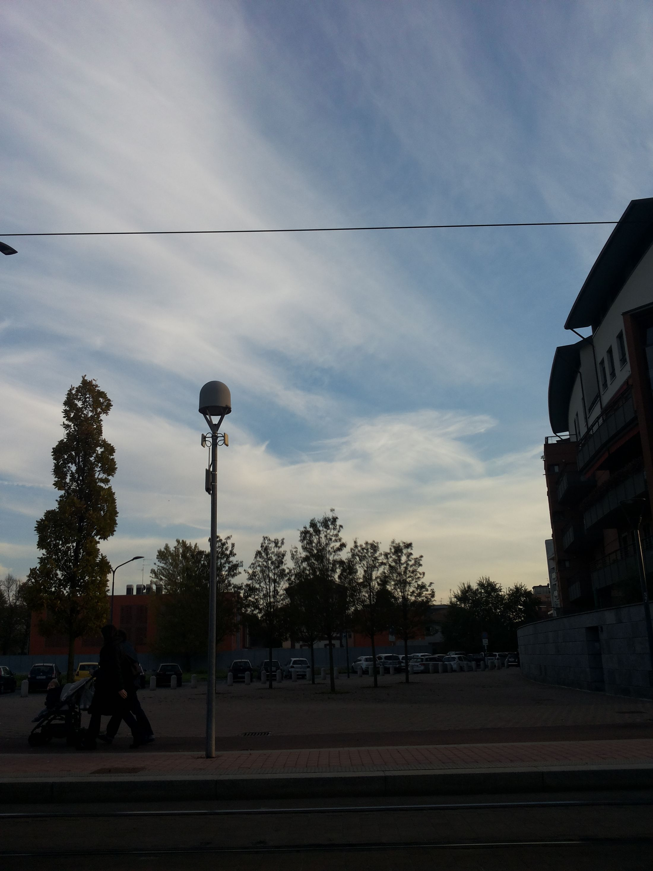 At The Tram Stop, Autumn Afternoon. Milan Sky Clouds And Sky Watching The Sky