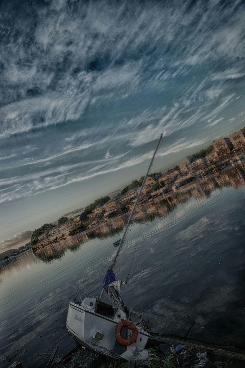 Sailboat On Lake At Dusk