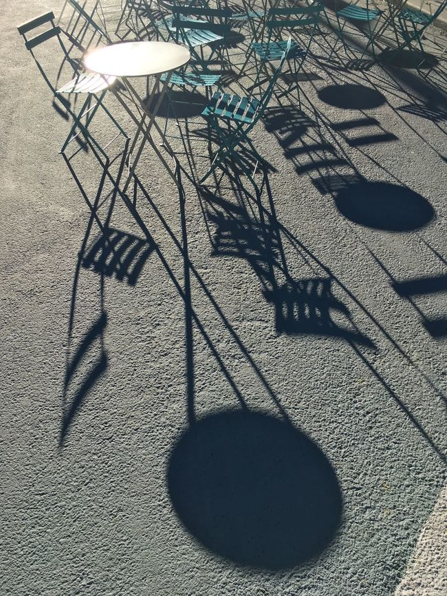 Focus On Shadow High Angle View No People Outdoors Shadow Sunlight Surface Level Tourism Tranquil Scene Tranquility Chairs
