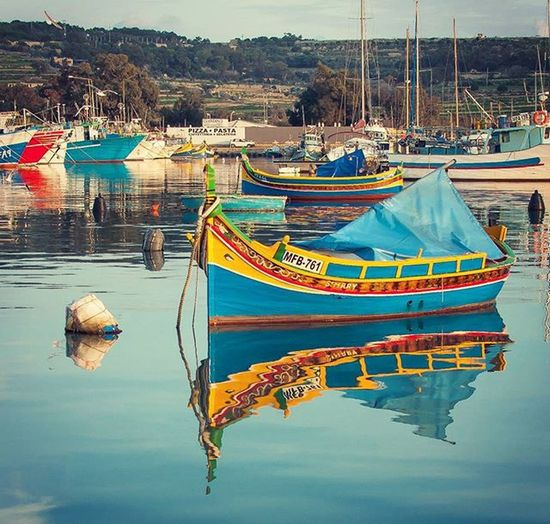 {Colorful reflections in the sea} Colourful Reflections Seaporn Sea Marsaxlokk Boat Luzzu Maltaexperience2015 Blue Yellow Travelling Reflection Riflessi Osiride Traveller Travelling MadeInSud Nikonphotography Nikond90 Sunset