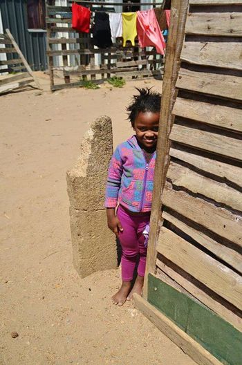 Walking through the street of a Township in Cape Town , when i Stumbled Upon this little Girl . Color Portrait Potrait South Africa Hideandseek