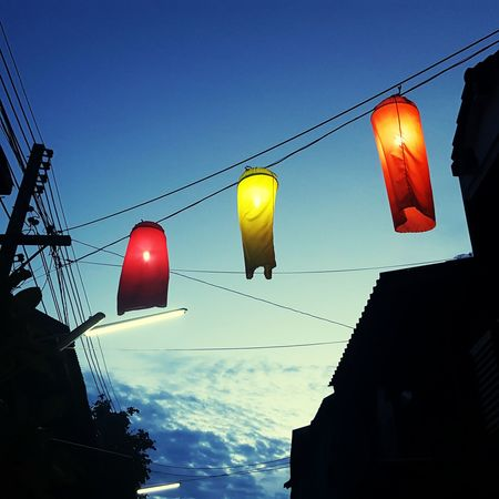 Three Little Ghosts Cable Low Angle View Power Line  Hanging Illuminated Blue Power Cable Building Exterior Back Lit Sky Cloud - Sky Street Lit Lanterns Lantern Light Twilight Time Twilight Scene Twilight Twilight Hour Urban City Ratchaburi Ratchaburi, Thailand Thailand Finding New Frontiers