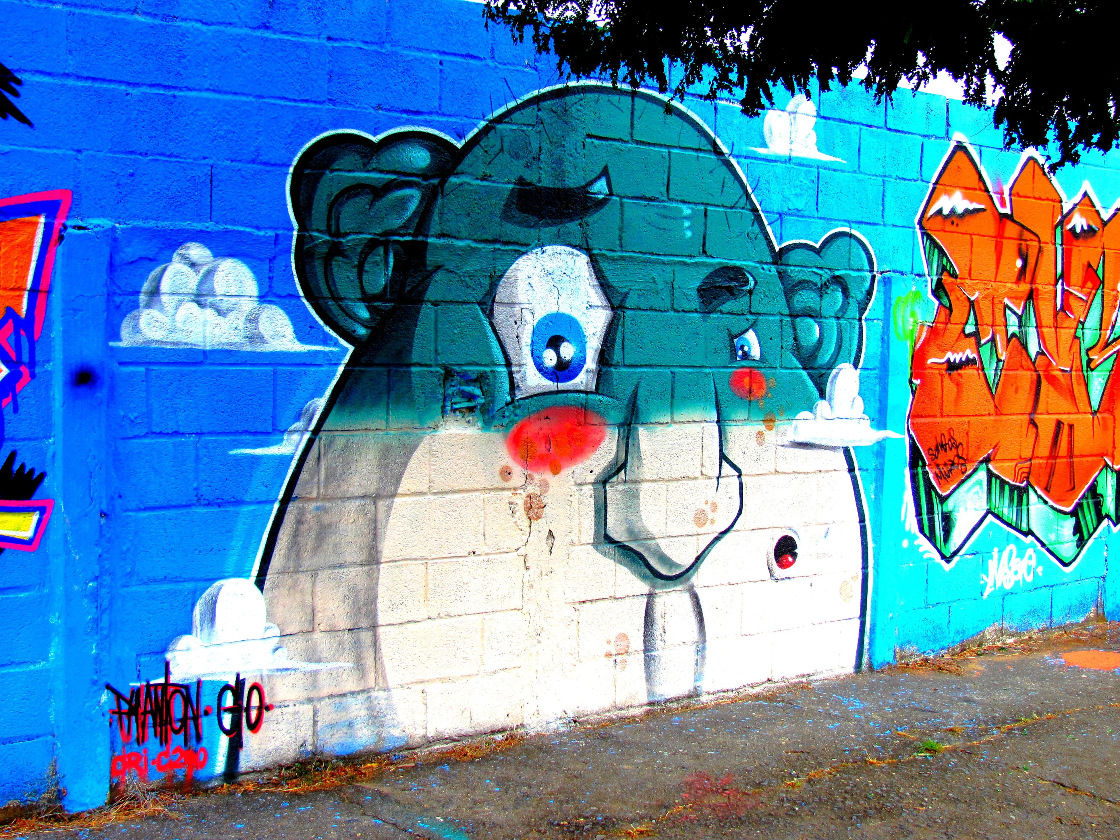 graffiti, street art, blue, outdoors, day, built structure, no people, multi colored, architecture