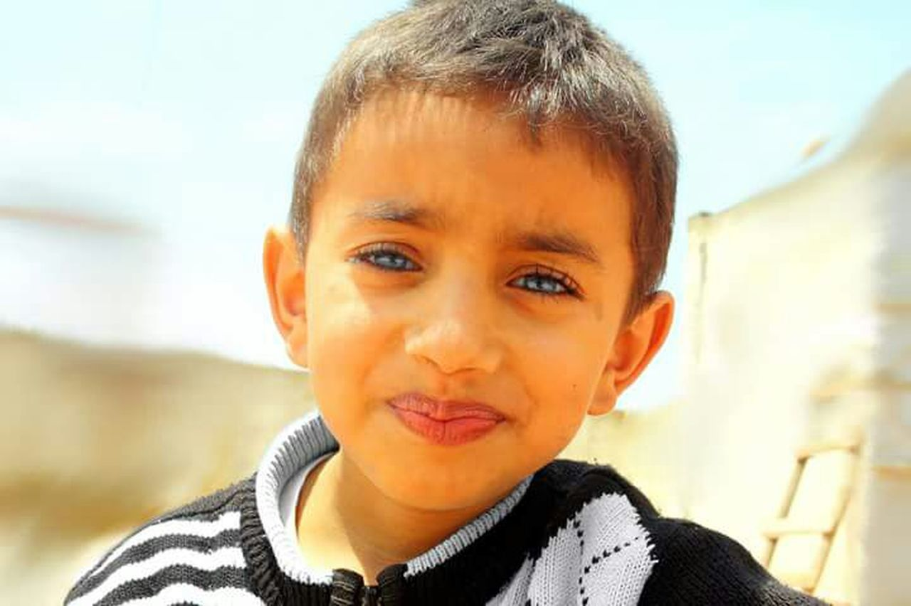childhood, children only, child, one boy only, boys, looking at camera, portrait, one person, headshot, males, people, cute, close-up, outdoors, human body part, day, human face, smiling