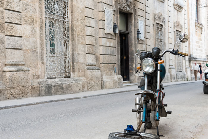 Architecture Bike Broken Building Exterior Built Structure City Life Every Day Everyday Fixing Flat Tire Havana Cuba Land Vehicle Lifestyle Mode Of Transport Motor Scooter Old Havana Repairing Revolution Sight Socialism Typical Unesco UNESCO World Heritage Site Urban Way Of Life
